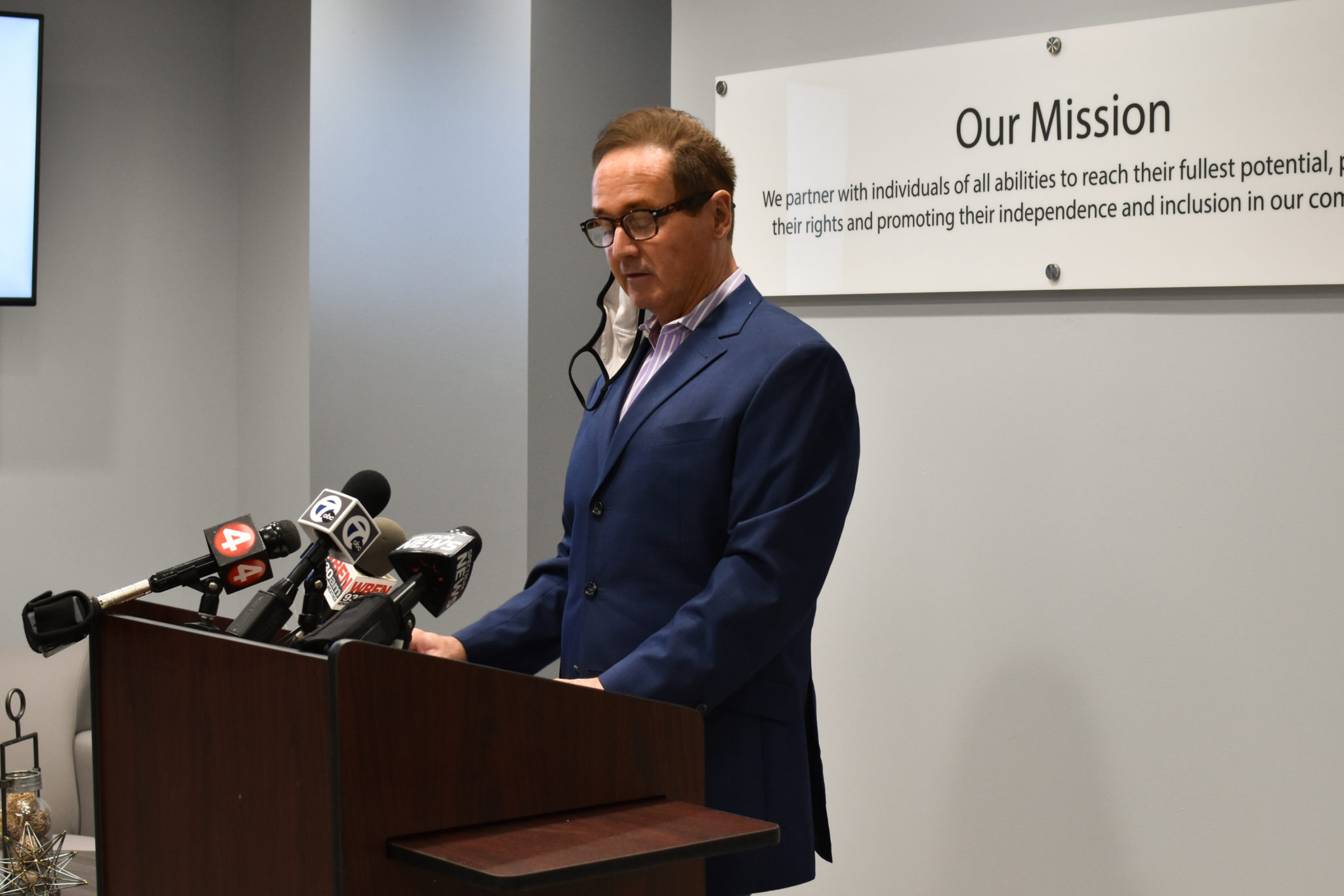 Congressman Brian Higgins speaks at a press conference announcing federal funding to assist survivors of domestic violence