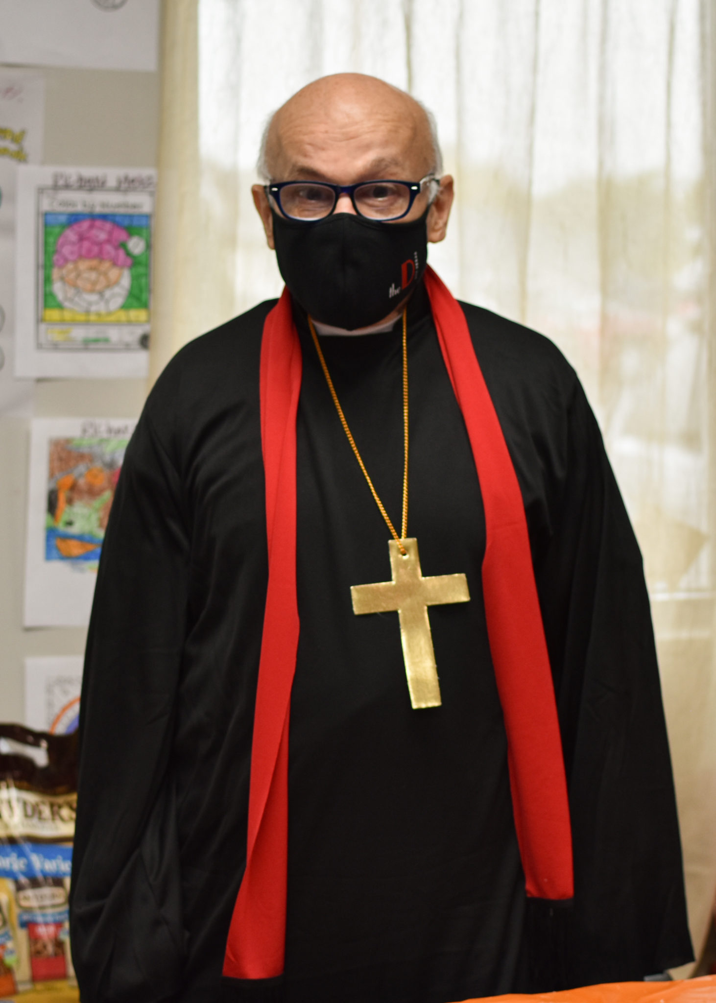 A man we support is dressed like a priest for Halloween