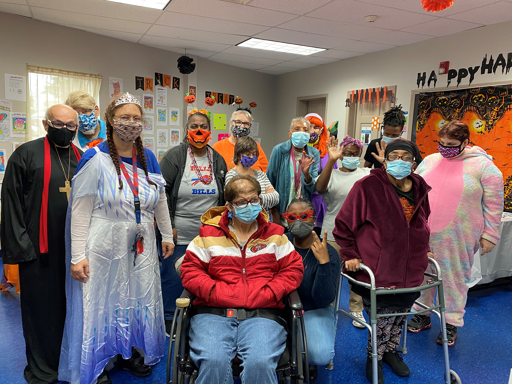 Our Community Based Day Habilitation group poses for picture in their costumes
