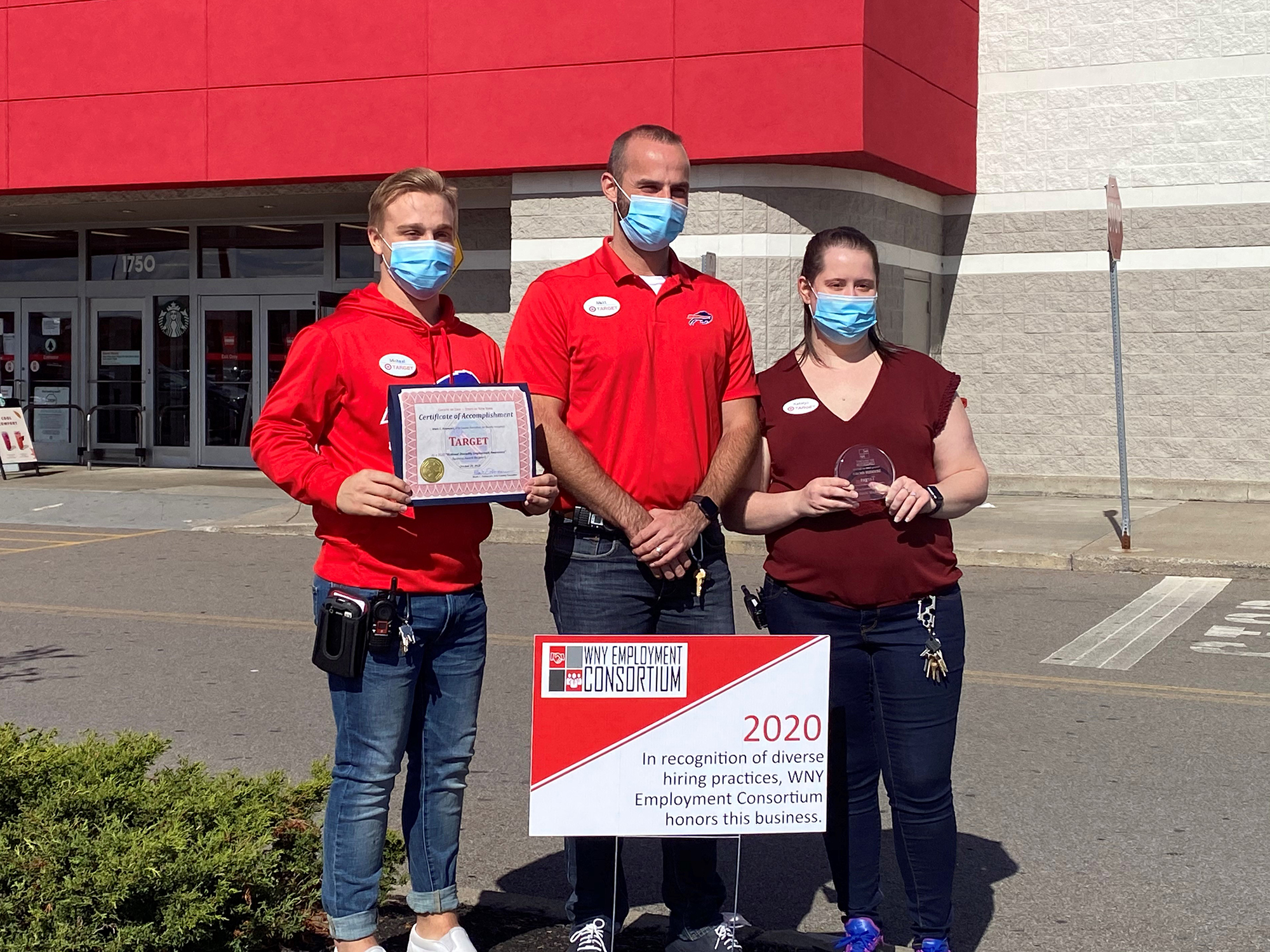 Target staff pose outside of the store with their Exemplary Employer sign.