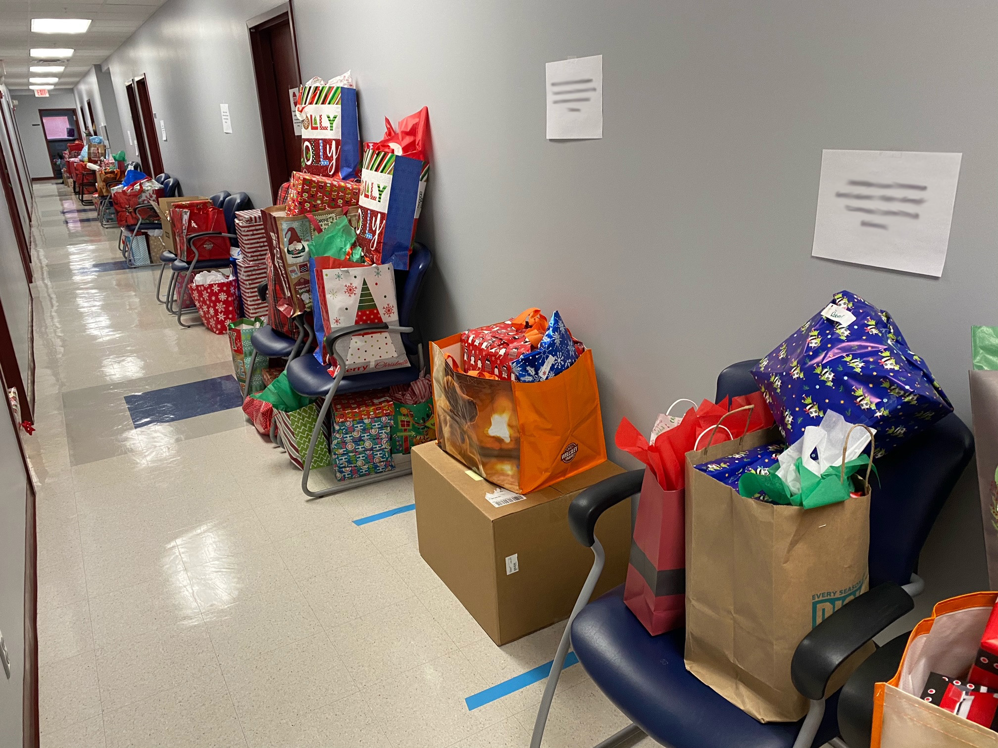 A hallway full of wrapped gifts donated to our campaign