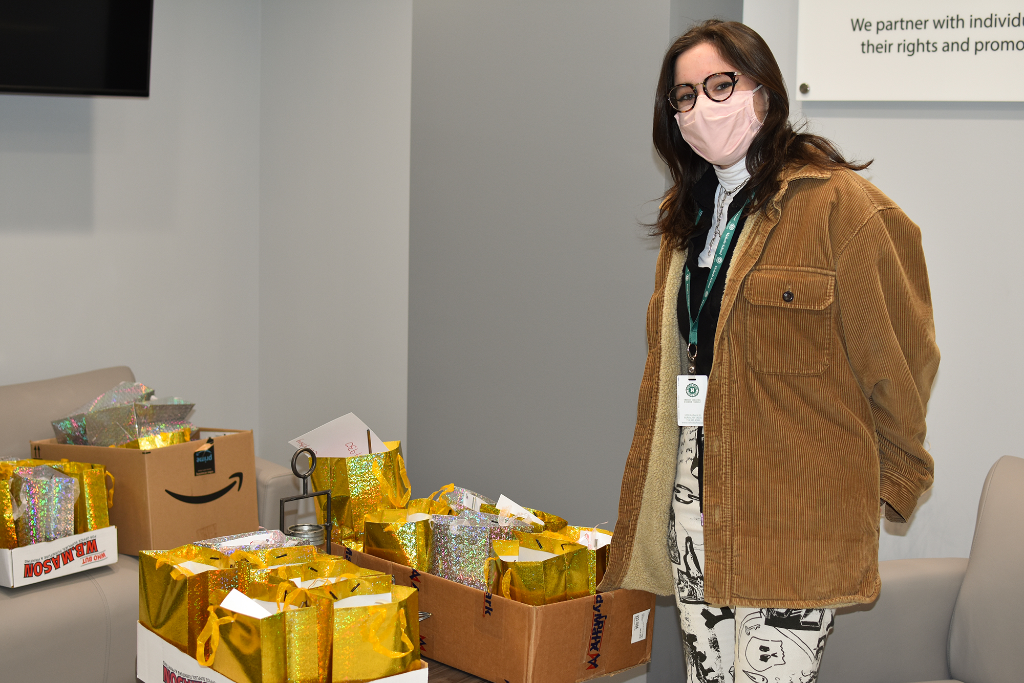 A Nichols student poses with the gift bags she donated
