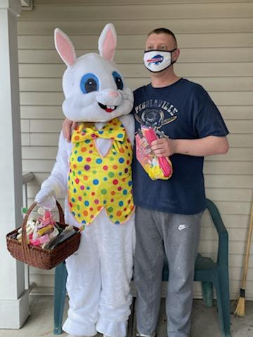 The Easter Bunny poses with a man we support
