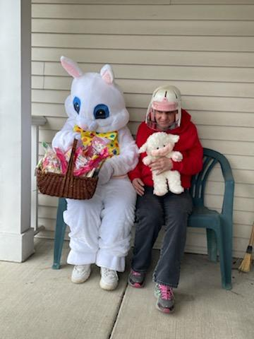 The Easter Bunny gives a basket to a woman we support
